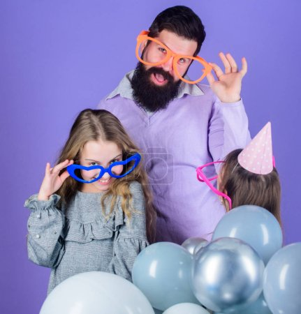 Photo for Friendly family wear funny party accessories. Fathers day. Daughters need father actively interested in life. Single father. Birthday party. Father with two daughters having fun. Fatherhood concept. - Royalty Free Image