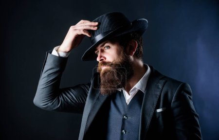 Photo for Searching for fashion muse. Businessman in suit. brutal caucasian hipster with moustache. Detective in hat. Mature hipster with beard. Secret shy. Male formal fashion. Bearded man gentleman. - Royalty Free Image