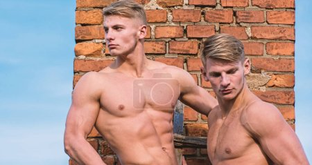 Photo for Strength and grace. Men muscular athlete bodybuilder show muscles. Men muscular chest naked torso stand brick wall background. Strong muscles emphasize masculinity sexuality. Bodybuilder shape. - Royalty Free Image