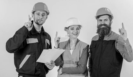 Photo for Men in hard hats, uniform and woman. Idea and creativity concept. Builder and engineer found out how to solve problem, have idea. Team of architects, engineers with document, isolated white background - Royalty Free Image