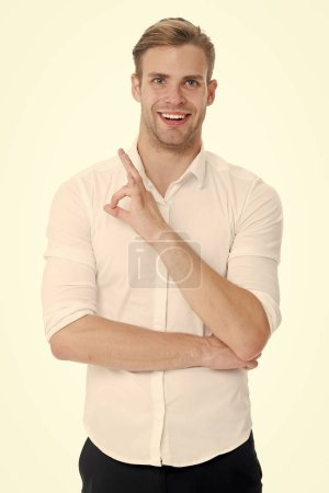 Photo for No problems. Man smiling face posing confidently ready to help white background. Guy with bristle glad to help you in shop. Man shop consultant looks confident and hospitable. Guy shows ok gesture. - Royalty Free Image