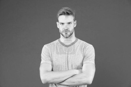 Photo for Strong and muscular. Man strict handsome unshaven guy on violet background. Masculinity concept. Man with muscular arms confident and strong. Does having muscular body make you more confident. - Royalty Free Image