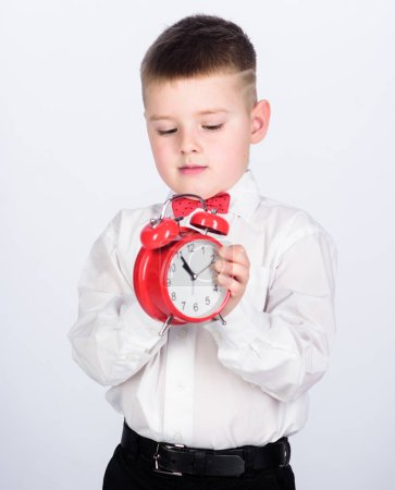 Photo for Tuxedo kid. Happy childhood. Party time. Businessman. Formal wear. Time management. Morning. little boy with alarm clock. Time to relax. happy child with retro clock in bow tie. what time is it. - Royalty Free Image