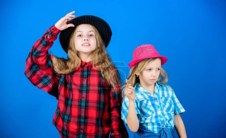 Photo for Happy childhood. Kids fashion concept. Check out our fashion style. Fashion trend. Girls kids wear fashionable hats. Small fashionista. Following sister in everything. Cool cutie fashionable outfit. - Royalty Free Image