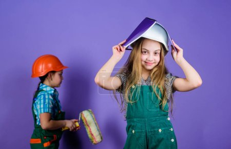 Photo for Future profession. small girls repairing together in workshop. Child care development. Builder engineer architect. Kid worker in hard hat. Tools to improve yourself. Repair. Repairing home together. - Royalty Free Image