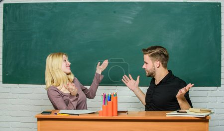 Photo for High school education. Couple studying in classroom. Man and woman back to school. Pretty teacher and handsome schoolmaster. University or college students happy smiling at desk. We did it. - Royalty Free Image