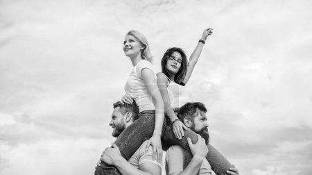 Photo for Just let the good times roll. Loving couples enjoy fun together. Loving couples having fun activities outdoor. Playful couples in love smiling on cloudy sky. Happy men piggybacking their girlfriends. - Royalty Free Image
