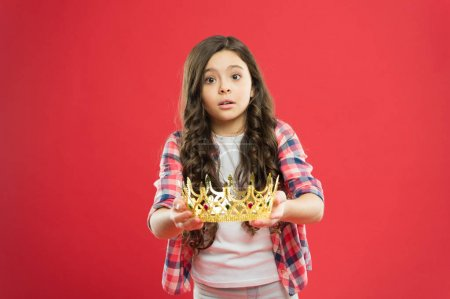Photo pour This is for you. Take it. Happiness and joy. Kid wear golden crown symbol of princess. Girl cute baby wear crown. Become princess concept. Every girl dreaming to be princess. Lady little princess. - image libre de droit