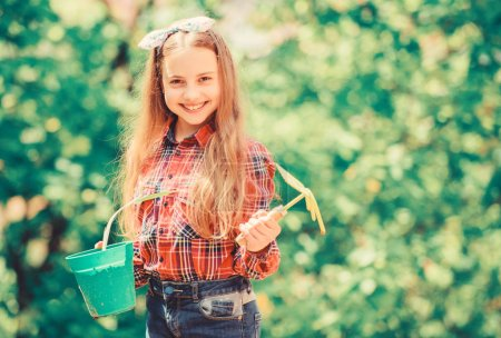 This flower is yours. ecology environment. Happy childrens day. spring village country. summer farm. Happy childhood. little girl with gardening tools. earth day. little girl kid in forest. Gardening