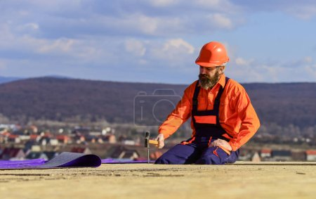 Photo for Flat roof installation. Roofer constructing new roof. Estimate materials requirements for projects. Install roofing materials. Heat insulation. Man roofing surface. Professional master repair roof. - Royalty Free Image