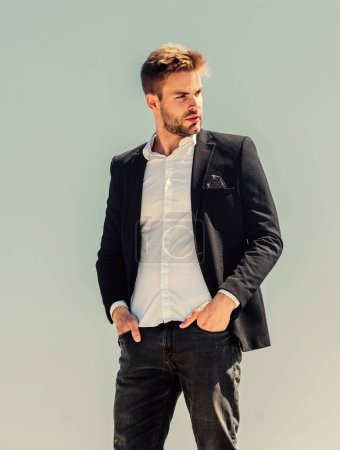 Photo for Sexy macho man. male grooming. confident businessman. Handsome man fashion model. success concept. Sky background. formal male fashion. modern lifestyle. Bearded guy business style. online business. - Royalty Free Image