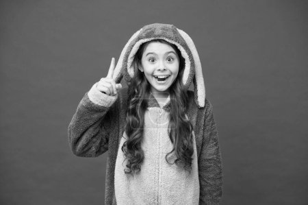 Photo for Inspired rabbit child relax. Baby animal. create your morning. comfortable homewear fashion. small girl wear easter bunny costume. happy kid in kigurumi pajama. pajama for your cozy sleep. - Royalty Free Image