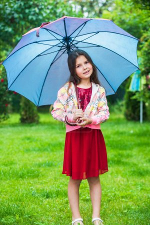autumn time. small girl hold cute kitten. kid love her pet. human and animals. love and care. fluffy cat in hand of pretty child. little beauty outdoor under umbrella. happy childhood. pet lover