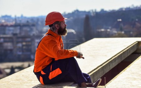 Photo for Roofer working. Roofer working tool. Construction Industry and Waterproofing. roofer working on roof structure of building on construction site. roofer wear safety uniform inspection. - Royalty Free Image