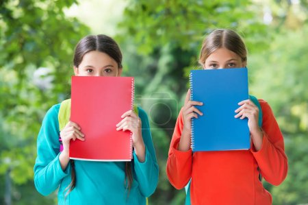 Get more knowledge. Little children cover faces wi...