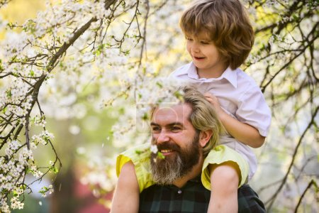 Photo for Best dad ever. Child having fun with dad. Happy family. Little boy and father in nature background. Springtime. Hipster piggybacking baby. Bearded brutal man good father. Fathers day. Dad and son. - Royalty Free Image