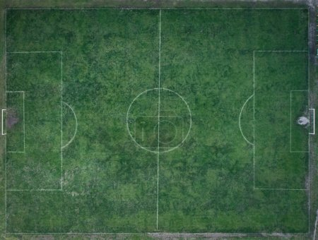Old, dirty Football field, top view. Flat lay