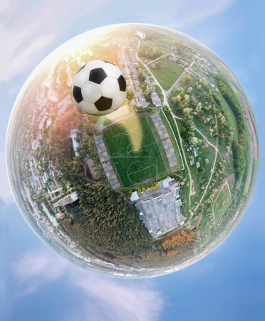 The football world. Planet of the soccer. Panoramic shot of the stadium and the ball