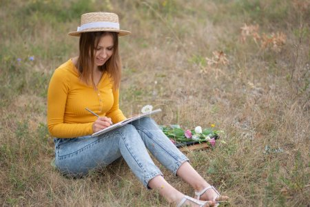 Photo for Girl drawing  a sketch outdoors - Royalty Free Image