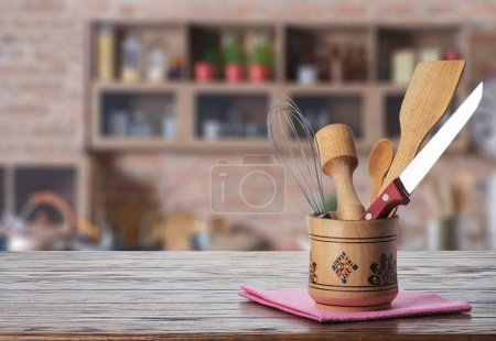 Photo for Kitchen - blurred background. accessories on wooden table - Royalty Free Image