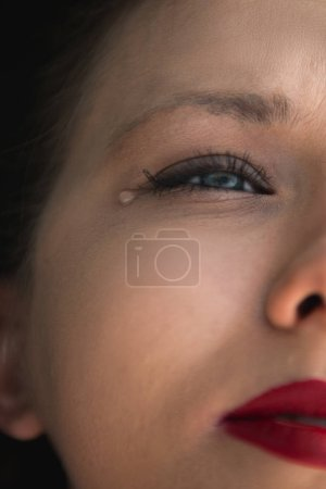 Photo for Young  woman is crying, close up - Royalty Free Image