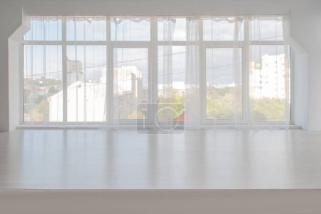 White room with large window
