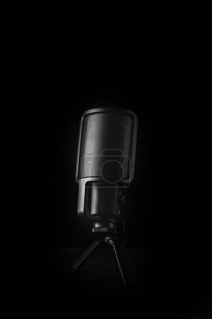 Photo for Black microphone on black background - Royalty Free Image