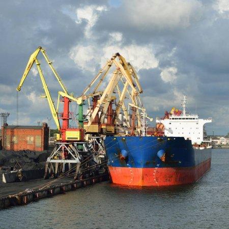 Large bulker ship loading coal in Ventspils free port