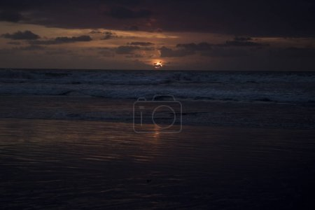 scenic view of ocean during sunset time with cloudy sky on background