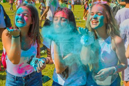 """Photo for Thessaloniki, Greece - September 2, 2018: Crowds of unidentified people throw colour powder during the """"Day of Colours"""" annual event. - Royalty Free Image"""