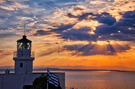 Photo for Celebration of the World Day of Lighthouses in Megalo Emvolo of Aggelochori in Thessaloniki. International Lighthouse and Lightship Weekend - Royalty Free Image