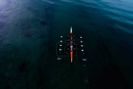 Photo for Thessaloniki, Greece - November 24, 2018: Aerial shot of women's Rowing Team during training in the Thermaic Gulf in Thessaloniki - Royalty Free Image