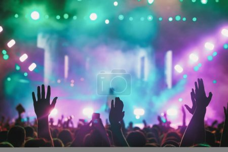 Photo for People taking photographs with touch smart phone during a music entertainment public concert.  live concert, music festival, happy youth, luxury party, landscape exterior. Selctive Focus - Royalty Free Image