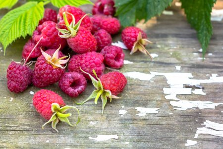 Photo for Fresh red raspberries on wooden table surface - Royalty Free Image