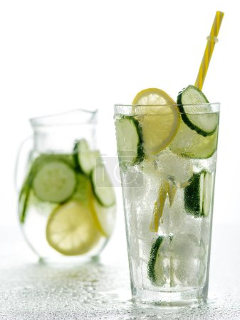 Photo for Healthy detox fizzy water with lemon and cucumber in Highball glass. Fresh Summer Drink. Healthy food concept. Detox diet. - Royalty Free Image