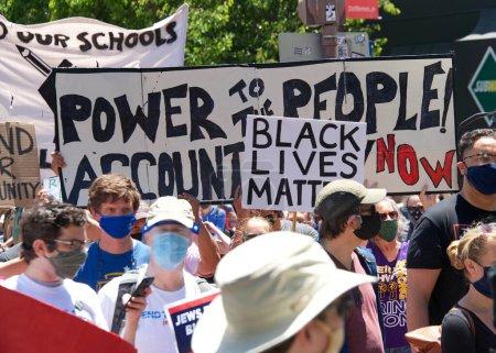 Berkeley, CA - June 13, 2020: Hundreds of people p...