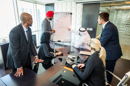 Multicultural business people meeting and talking about business - Multiracial business team meeting