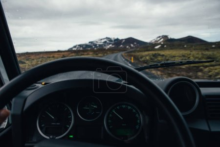 Man exploring iceland. Driving through the lands