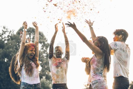 Photo for Group of teens playing with colors at the holi festival, in a park - Royalty Free Image
