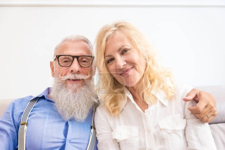Senior couple in the 60's having fun at home - Cheerful married couple portrait, concepts about senority and relationship