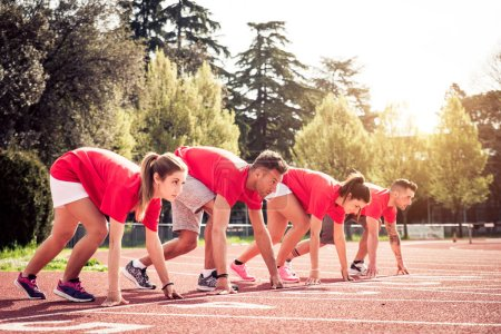 Photo for Group of athletes sprinting on a runner track - Royalty Free Image