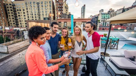 Photo for Young happy people having a barbecue dinner on a rooftop in New York - Group of friends having party and having fun - Royalty Free Image