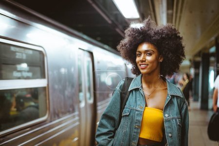 Happy african american woman smiling. Beautiful young female walking and having fun in New York city
