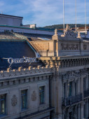 ZURICH, SWITZERLAND - AUGUST 27, 2015: View of the rooftop of Credit Suisse headquarter in Paradeplatz, Zurich with uview of the balcony and windows