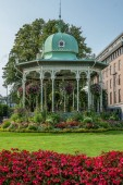 A gazebo covered in flowers in the center of Bergen in Norway in
