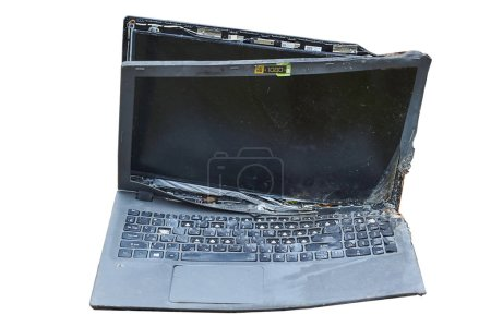 The laptop is broken and burned in the fire.