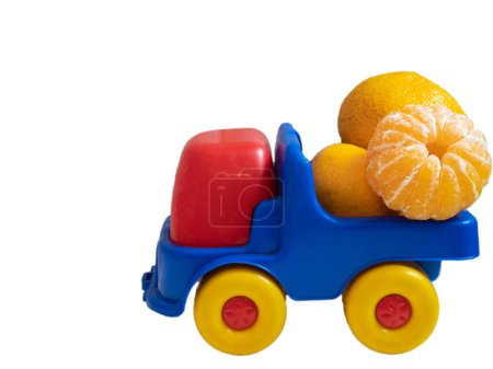colorful toy car truck with mandarines tangerines. side shot isolated on white background