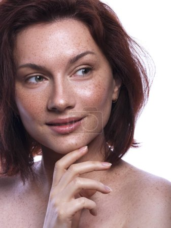 Cute brunette woman with freckles all over her face. Clean flawl