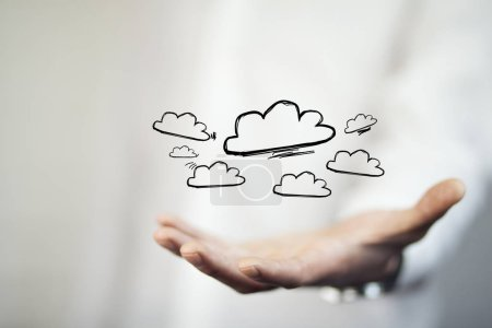 Man with clouds over his  hand, concept