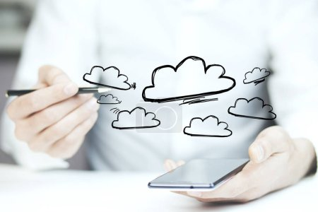 Concept view of cloud stockage with icon around a smartphone